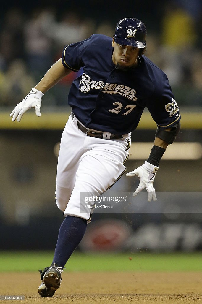 Carlos Gomez #27 of the Milwaukee Brewers rounds the bases after hitting a solo home run in the bottom of the 4th inning against the San Diego Padres at Miller Park on October 1, 2012 in Milwaukee, Wisconsin.