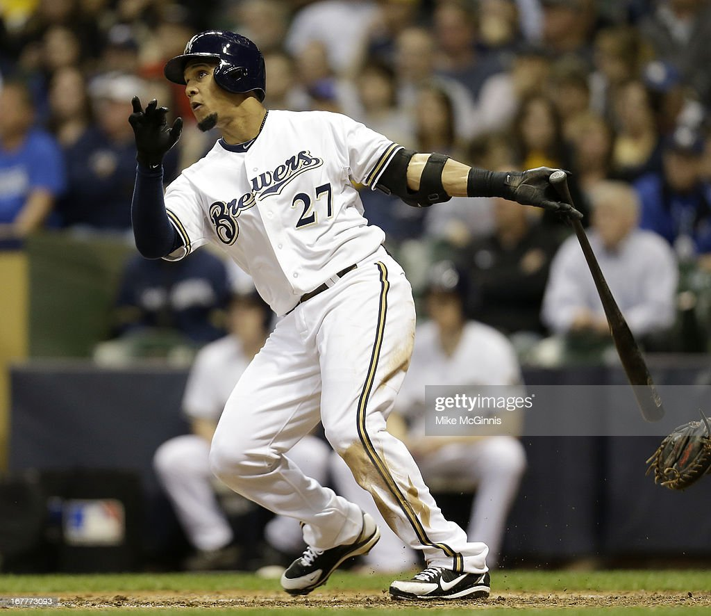Carlos Gomez #27 of the Milwaukee Brewers sends this pitch over the wall for a solo homer in the bottom of the fifth inning against the Pittsburgh Pirates at Miller Park on April 29, 2013 in Milwaukee, Wisconsin.