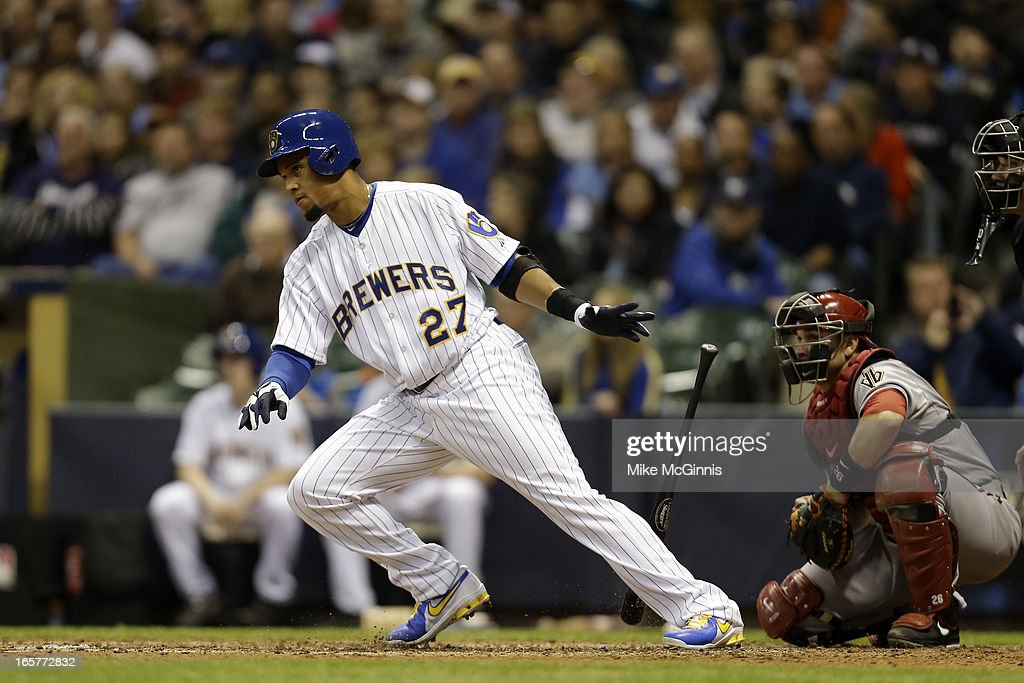 Carlos Gomez #27 of the Milwaukee Brewers singles in the bottom of the fifth inning against the Arizona Diamondbacks at Miller Park on April 5, 2013 in Milwaukee, Wisconsin.