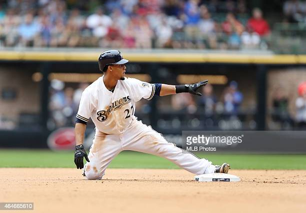 Carlos Gomez of the Milwaukee Brewers slides into second base during the game against the Cincinnati Reds at Miller Park on Wednesday August 8 2012...