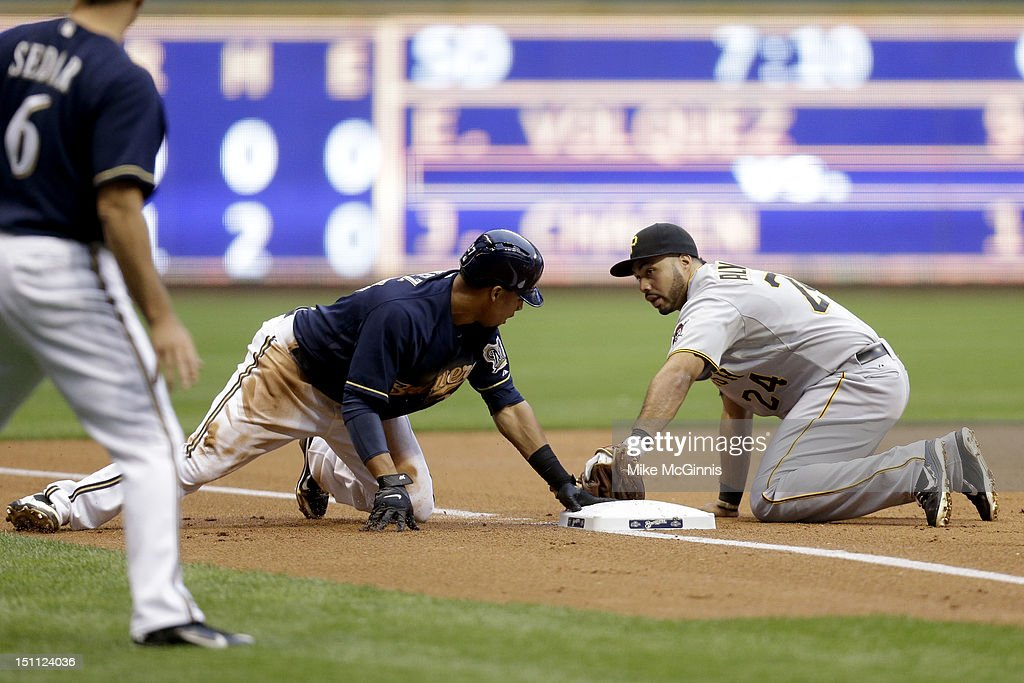 Carlos Gomez #27 of the Milwaukee Brewers steals third base during the bottom of the 3rd inning against the Pittsburgh Pirates at Miller Park on September 01, 2012 in Milwaukee, Wisconsin.