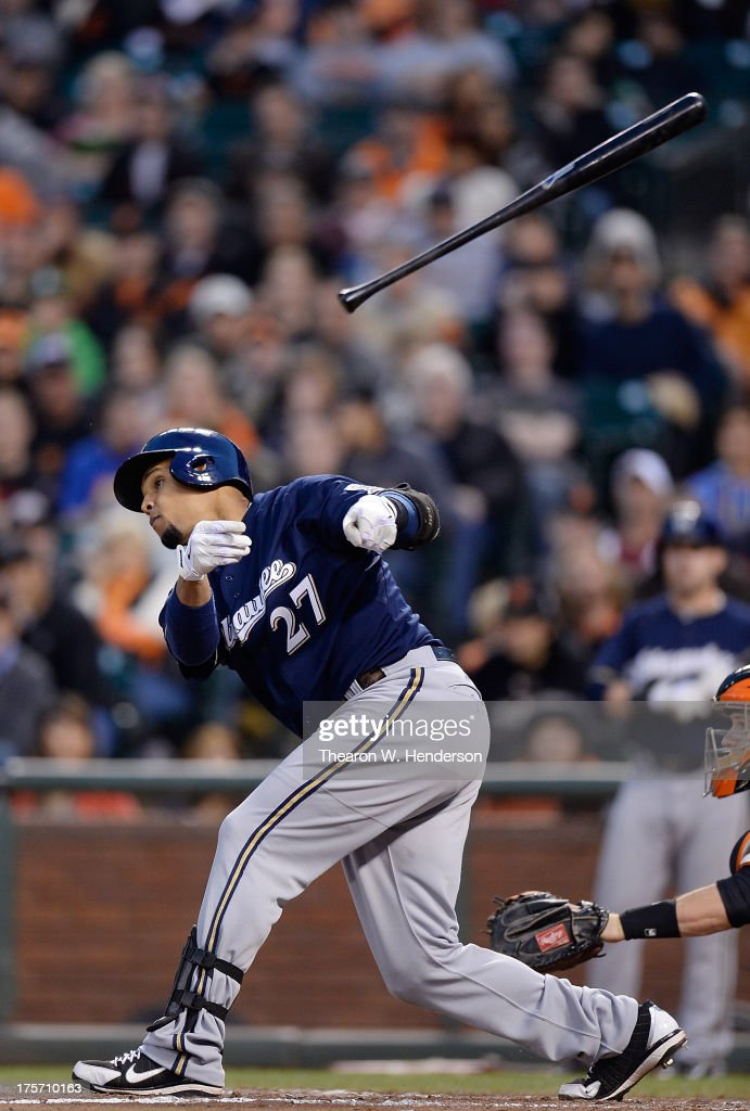 Carlos Gomez #27 of the Milwaukee Brewers swings and loses control of his bat tossing it into the stands during the fourth inning against the San Francisco Giants at AT&T Park on August 6, 2013 in San Francisco, California.