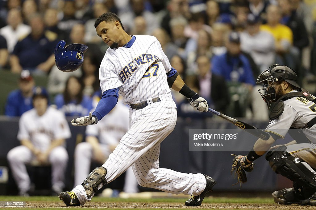 Carlos Gomez #27 of the Milwaukee Brewers swings at strike two during the bottom of the fifth inning against the Pittsburgh Pirates at Miller Park on April 12, 2014 in Milwaukee, Wisconsin.