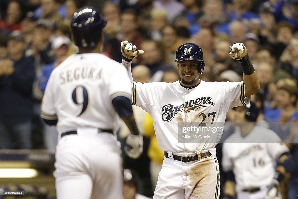 Carlos Gomez #27 of the Milwaukee Brewers waits for <a gi-track='captionPersonalityLinkClicked' href=/galleries/search?phrase=Jean+Segura&family=editorial&specificpeople=7521808 ng-click='$event.stopPropagation()'>Jean Segura</a> #9 at home plate after Segura hit a two-run homer in the bottom of the sixth inning against the Arizona Diamondbacks at Miller Park on April 05, 2014 in Milwaukee, Wisconsin.