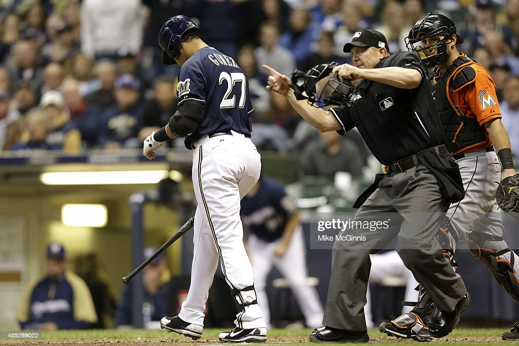 Carlos Gomez #27 of the Milwaukee Brewers walks to first base after getting hit by a pitch by Anthony DeSlafani of the Miami Marlins during the bottom of the sixth inning at Miller Park on September 11, 2014 in Milwaukee, Wisconsin.