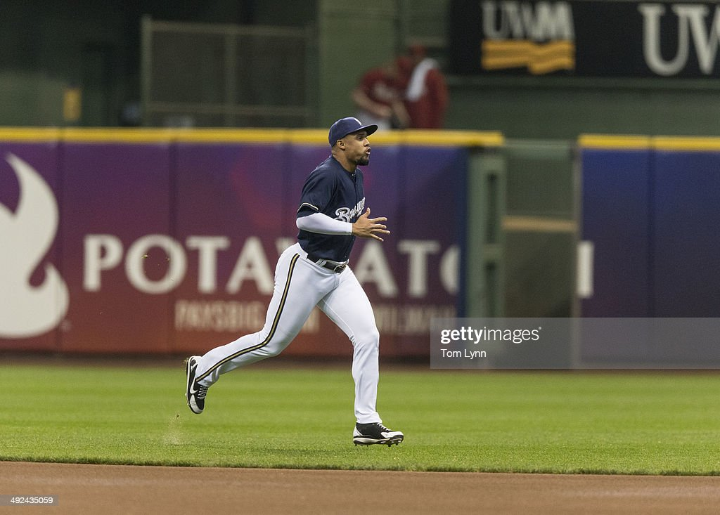 Carlos Gomez #27 of the Milwaukee Brewers warms up before the start of the game against the Arizona Diamondbacks at Miller Park on May 7, 2014 in Milwaukee, Wisconsin.