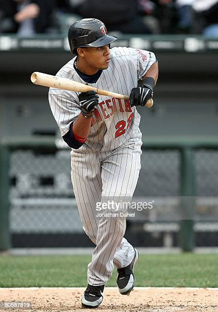 Carlos Gomez of the Minnesota Twins moves to bunt against the Chicago White Sox during the Opening Day game on April 7 2008 at US Cellular Field in...