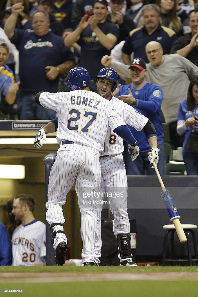 Carlos Gomez #27 of the Pittsburgh Pirates celebrates with Ryan Braun #8 after hitting a lead off solo home run in the bottom of the first inning against the Milwaukee Brewers at Miller Park on April 12, 2014 in Milwaukee, Wisconsin.