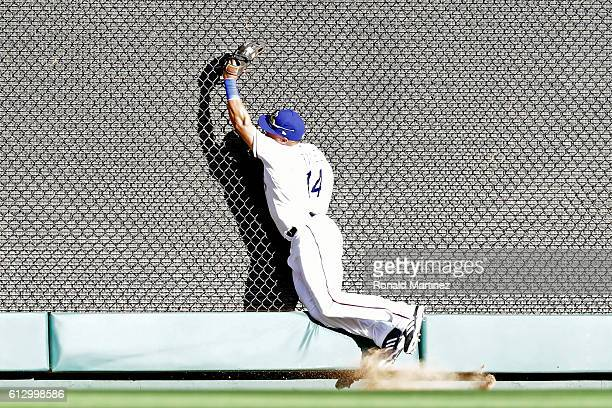 Carlos Gomez of the Texas Rangers catches a fly ball in left field hit by Edwin Encarnacion of the Toronto Blue Jays during the sixth inning in game...
