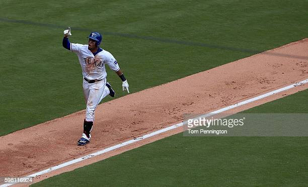 Carlos Gomez of the Texas Rangers celebrates after hitting a grand slam against Felix Hernandez of the Seattle Mariners in the bottm of the fourth...
