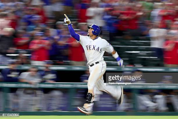 Carlos Gomez of the Texas Rangers celebrates after hitting a three run home run off of Tyler Thornburg of the Milwaukee Brewers in the bottom of the...
