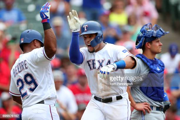 Carlos Gomez of the Texas Rangers celebrates with Adrian Beltre of the Texas Rangers after hitting a three run home run against the Toronto Blue Jays...