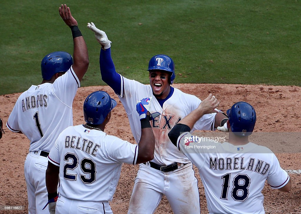 Carlos Gomez #14 of the Texas Rangers celebrates with Elvis Andrus #1 of the Texas Rangers, Adrian Beltre #29 of the Texas Rangers and Mitch Moreland #18 of the Texas Rangers after hitting a grand slam against Felix Hernandez #34 of the Seattle Mariners in the bottm of the fourth inning at Globe Life Park in Arlington on August 31, 2016 in Arlington, Texas.