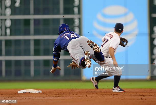 Carlos Gomez of the Texas Rangers doubles in the third inning as Jose Altuve of the Houston Astros awaits the throw at Minute Maid Park on September...