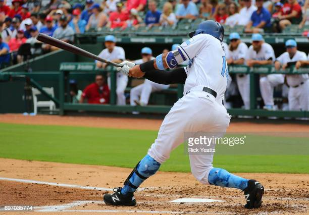 Carlos Gomez of the Texas Rangers hits a two run single in the first inning against the Seattle Mariners at Globe Life Park in Arlington on June 17...