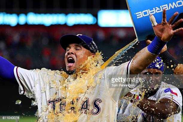 Carlos Gomez of the Texas Rangers is soaked with Powerade after hitting a three run home run off of Tyler Thornburg of the Milwaukee Brewers in the...