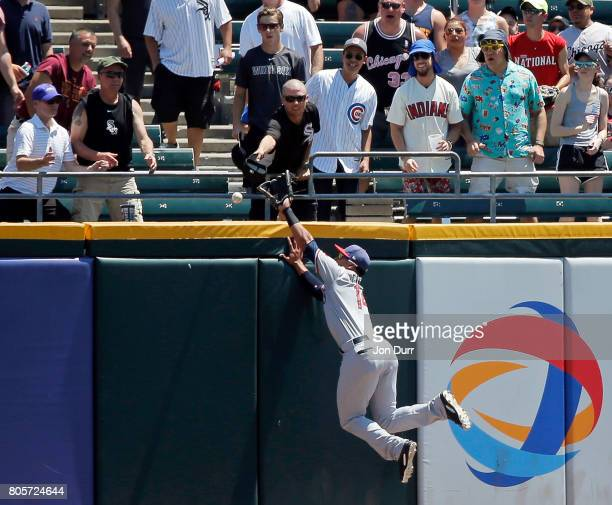 Carlos Gomez of the Texas Rangers is unable to catch the home run ball of Melky Cabrera of the Chicago White Sox during the first inning at...
