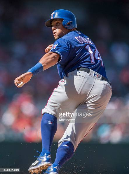 Carlos Gomez of the Texas Rangers runs after being caught in a rundown during the eighth inning of the game against the Los Angeles Angels of Anaheim...