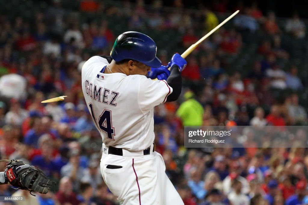 Carlos Gomez #14 of the Texas Rangers splinters his bat on a ground out in the first inning of a baseball game against the Houston Astros at Globe Life Park in Arlington on September 26, 2017 in Arlington, Texas.
