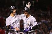 Carlos Gonzalez and Nolan Arenado of the Colorado Rockies celebrate after Arenado hit a threerun home run against the Arizona Diamondbacks during the...