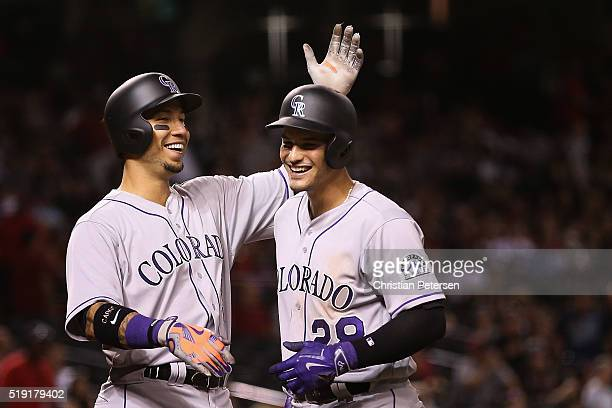 Carlos Gonzalez and Nolan Arenado of the Colorado Rockies celebrate after Arenado hit a threerun home run against the Arizona Diamondbacks during the...