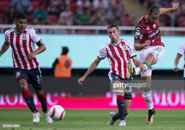 Carlos Gonzalez of Necaxa takes a shot and scores the first goal of his team during the third round match between Chivas and Necaxa as part of the...