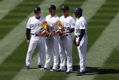 Carlos Gonzalez of the Colorado Rockies and Nolan Arenado of the Colorado Rockies receive thier 2013 Rawlings Gold Glove Awards prior to facing the...