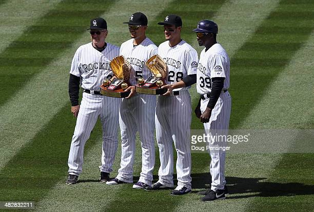 Carlos Gonzalez of the Colorado Rockies and Nolan Arenado of the Colorado Rockies receive their 2013 Rawlings Gold Glove Awards prior to facing the...