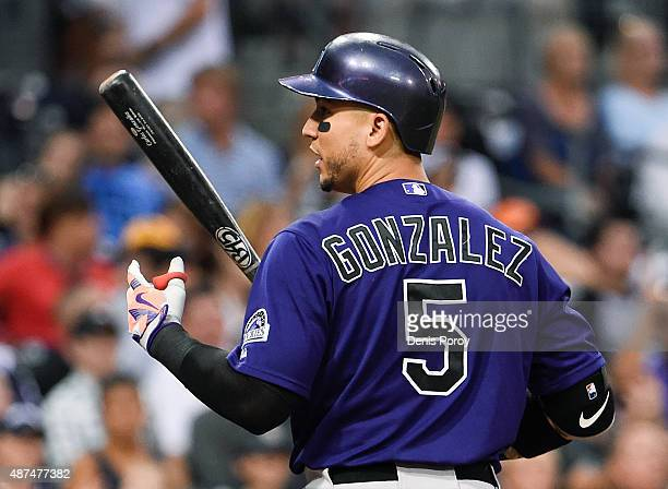Carlos Gonzalez of the Colorado Rockies argues after striking out during the third inning of a baseball game against the San Diego Padres at Petco...