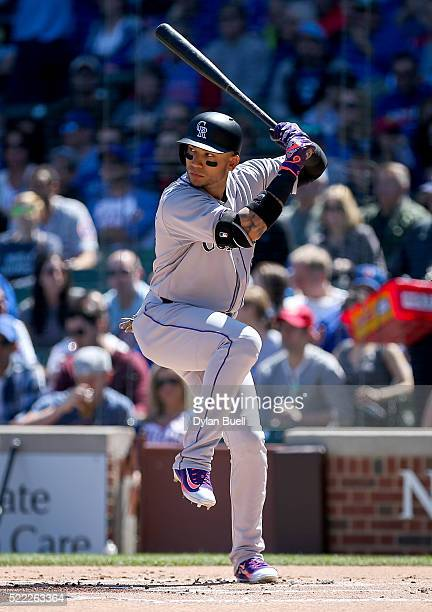 Carlos Gonzalez of the Colorado Rockies bats against the Chicago Cubs at Wrigley Field on April 16 2016 in Chicago Illinois