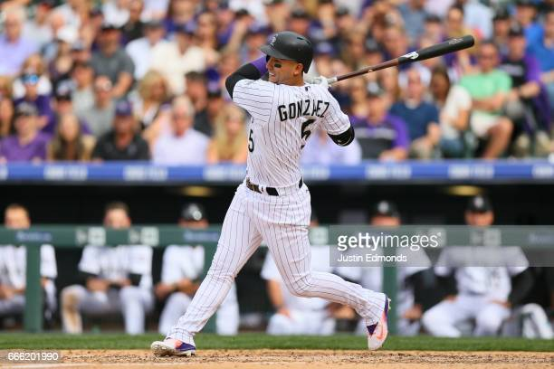 Carlos Gonzalez of the Colorado Rockies bats against the Los Angeles Dodgers on Opening Day at Coors Field on April 7 2017 in Denver Colorado