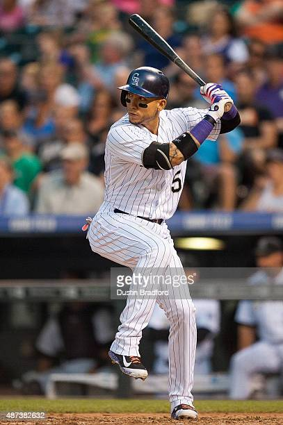 Carlos Gonzalez of the Colorado Rockies bats against the San Francisco Giants during a game at Coors Field on September 5 2015 in Denver Colorado