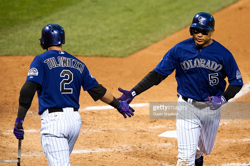Carlos Gonzalez #5 of the Colorado Rockies celebrates a solo home run with <a gi-track='captionPersonalityLinkClicked' href=/galleries/search?phrase=Troy+Tulowitzki&family=editorial&specificpeople=757353 ng-click='$event.stopPropagation()'>Troy Tulowitzki</a> #2 during the fifth inning of a game against the Tampa Bay Rays at Coors Field on May 4, 2013 in Denver, Colorado.