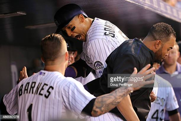 Carlos Gonzalez of the Colorado Rockies celebrates his solo home run off of starting pitcher Chris Heston of the San Francisco Giants with Wilin...