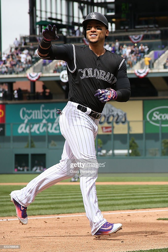 Carlos Gonzalez #5 of the Colorado Rockies celebrates his solo home run off of James Shields #33 of the San Diego Padres to take a 1-0 lead in the first inning on April 10, 2016 in Denver, Colorado.