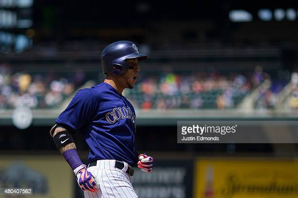 Carlos Gonzalez of the Colorado Rockies celebrates his two run home run during the first inning against the Atlanta Braves at Coors Field on July 11...