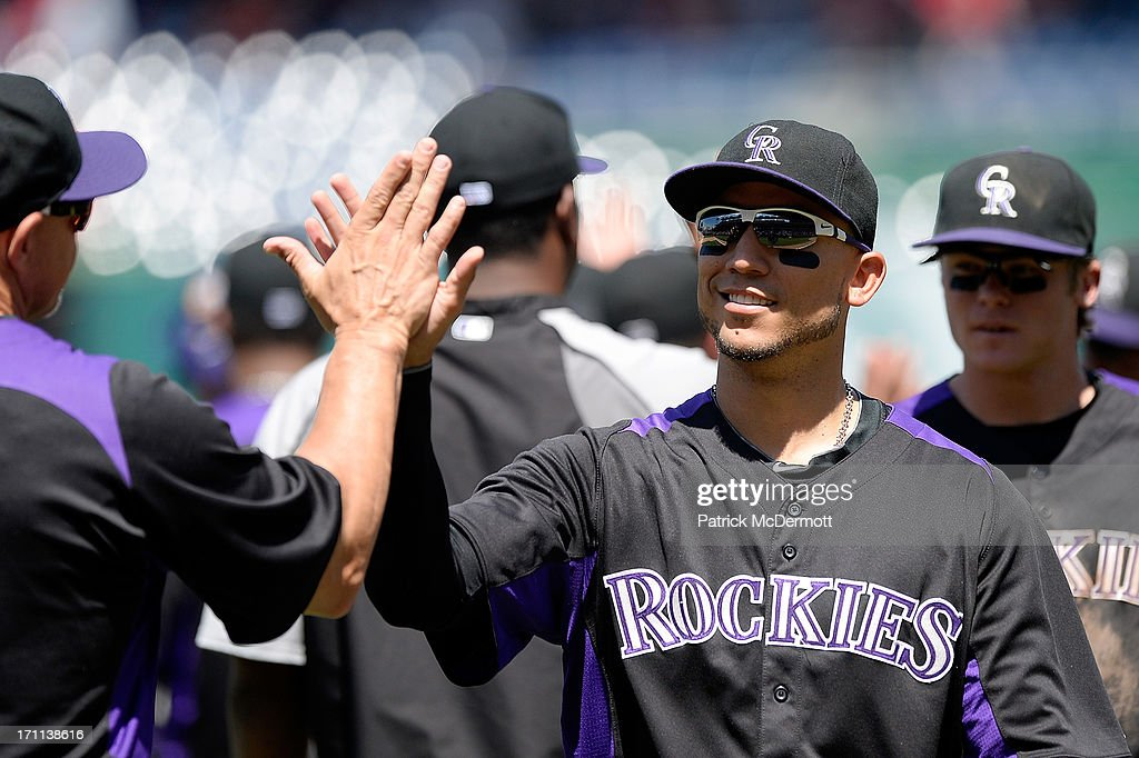 Carlos Gonzalez #5 of the Colorado Rockies celebrates with his teammates after the Rockies defeated the Washington Nationals 7-1 during a game at Nationals Park on June 22, 2013 in Washington, DC.