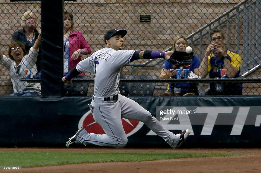 Carlos Gonzalez #5 of the Colorado Rockies dives to make a catch in the fourth inning against the Milwaukee Brewers at Miller Park on August 22, 2016 in Milwaukee, Wisconsin.