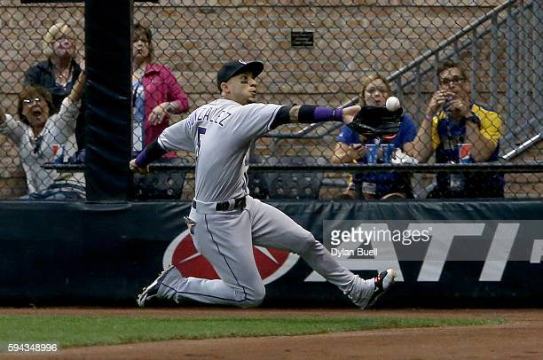 Carlos Gonzalez of the Colorado Rockies dives to make a catch in the fourth inning against the Milwaukee Brewers at Miller Park on August 22 2016 in...