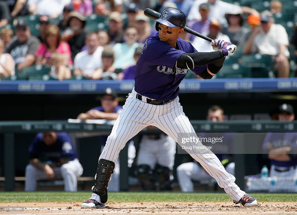 Carlos Gonzalez #5 of the Colorado Rockies eyes the pitch as he hits a three run home run off of Collin McHugh #31 of the Houston Astros to take a 3-1 lead in the first inning during interleague play at Coors Field on June 18, 2015 in Denver, Colorado.