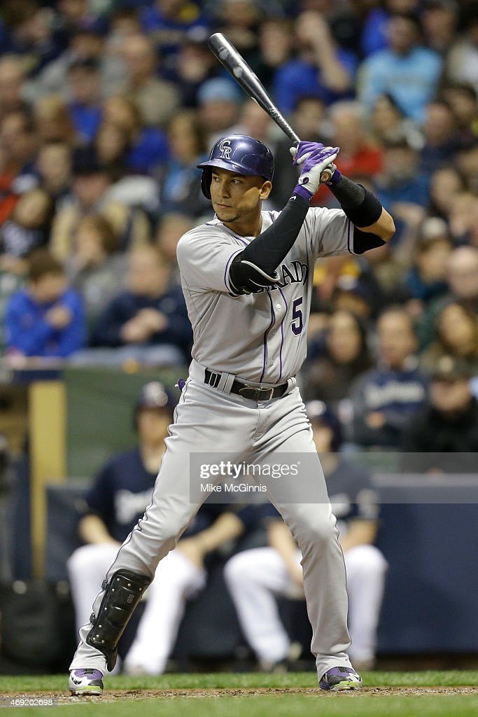 Carlos Gonzalez #5 of the Colorado Rockies gets ready for the next pitch during the game against the Milwaukee Brewers at Miller Park on April 07, 2015 in Milwaukee, Wisconsin.