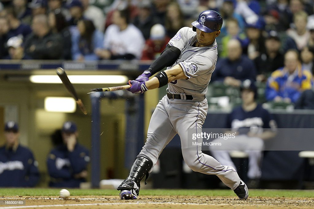 Carlos Gonzalez #5 of the Colorado Rockies hits a broken bat single in the top of the 7th inning against the Milwaukee Brewers at Miller Park on April 2, 2013 in Milwaukee, Wisconsin.