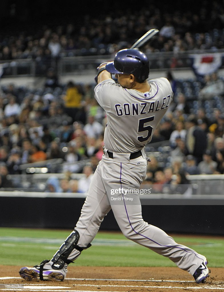 Carlos Gonzalez #5 of the Colorado Rockies hits a double in the first inning against the San Diego Padres at Petco Park on April 12, 2013 in San Diego, California.