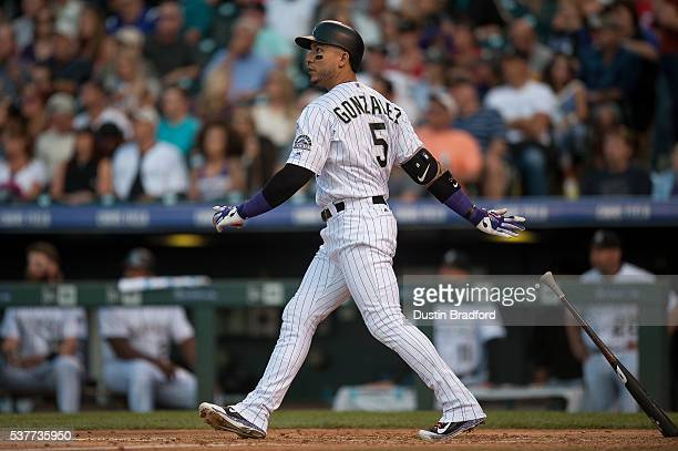 Carlos Gonzalez of the Colorado Rockies hits a fourth inning solo homerun off of Alfredo Simon of the Cincinnati Reds at Coors Field on June 2 2016...