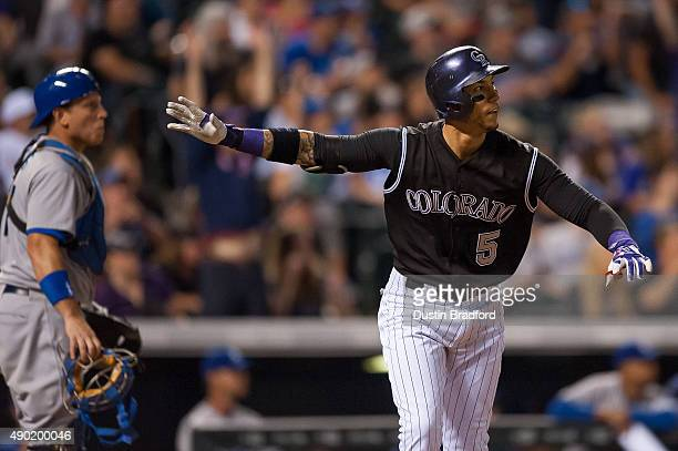 Carlos Gonzalez of the Colorado Rockies hits a ninth inning walkoff 2run home run off of Yimi Garcia of the Los Angeles Dodgers as AJ Ellis watches...