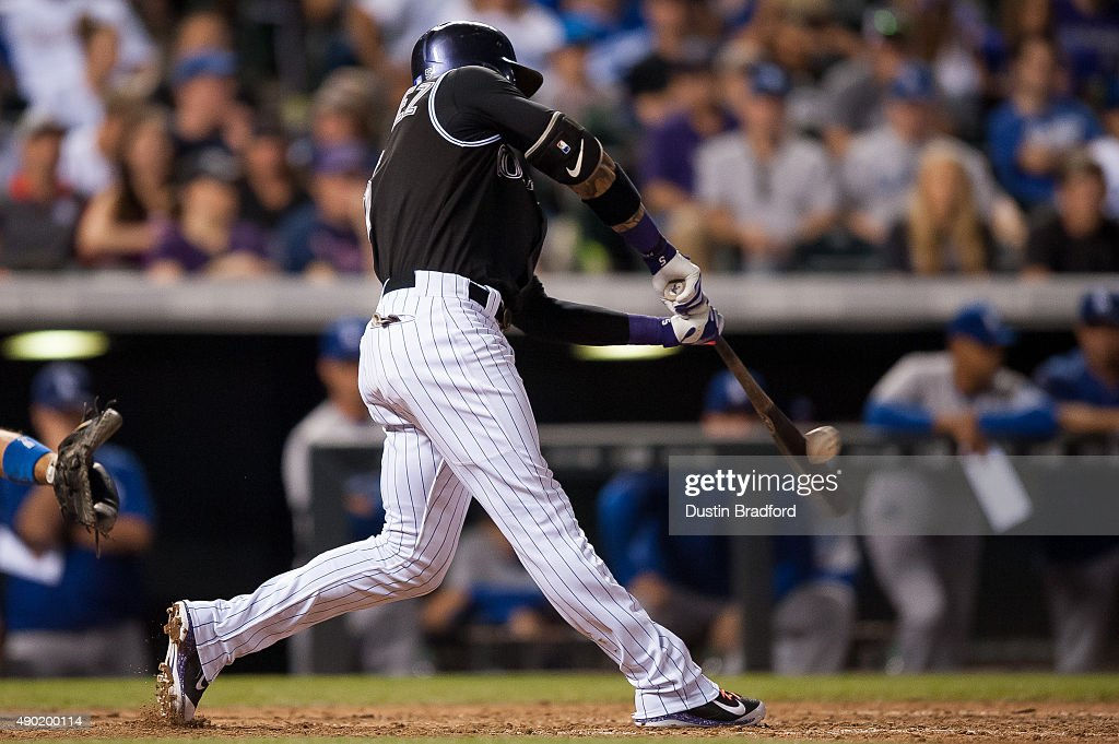 Carlos Gonzalez #5 of the Colorado Rockies hits a ninth inning walk-off 2-run home run off of Yimi Garcia #63 of the Los Angeles Dodgers (not pictured) during a game at Coors Field on September 26, 2015 in Denver, Colorado. The Rockies beat the Dodgers 8-6.