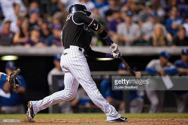 Carlos Gonzalez of the Colorado Rockies hits a ninth inning walkoff 2run home run off of Yimi Garcia of the Los Angeles Dodgers during a game at...