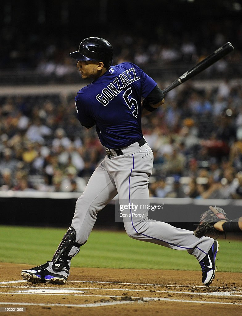 Carlos Gonzalez #5 of the Colorado Rockies hits a single during the first inning of a baseball game against the San Diego Padres at Petco Park on September 14, 2012 in San Diego, California.