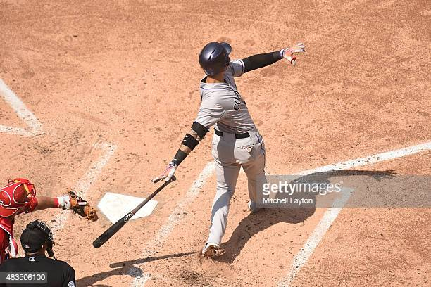 Carlos Gonzalez of the Colorado Rockies hits a solo home run in the sixth inning during a baseball game against the Washington Nationals at Nationals...
