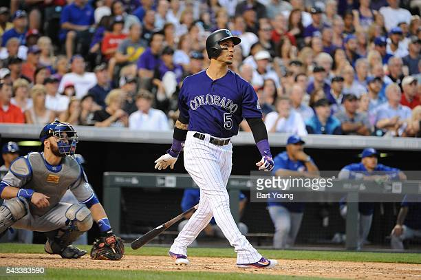 Carlos Gonzalez of the Colorado Rockies hits a three run home run in the sixth inning against the Toronto Blue Jays at Coors Field on June 27 2016 in...